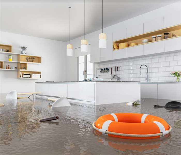 flooded kitchen in a house with furniture floating