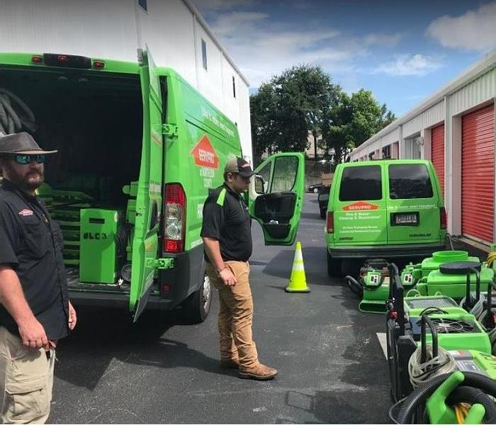 SERVPRO technicians unloading drying equipment outside storage facility