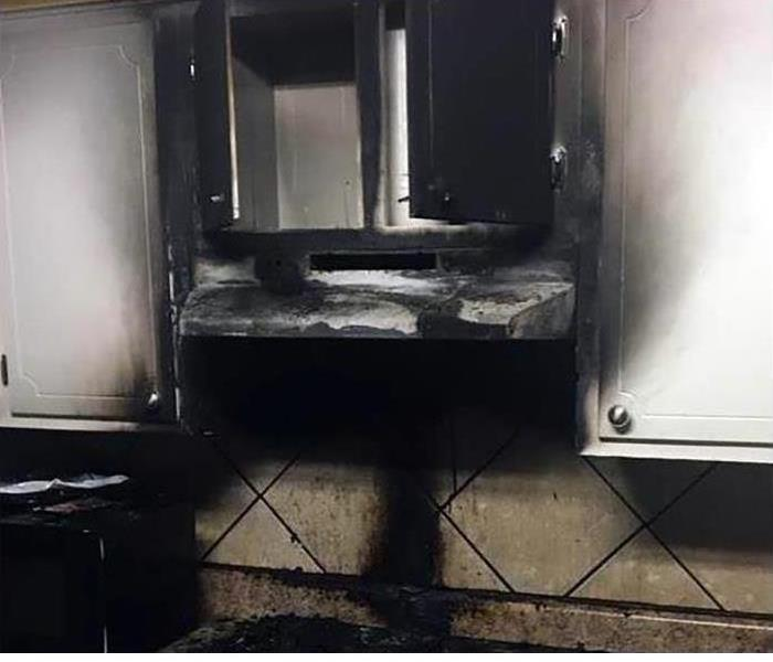 A kitchen that encountered a fire with smoke and soot damage